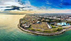 Aerial shot of Victorious Site. Portsmouth's coast with a view of the sea and a beautiful sunset
